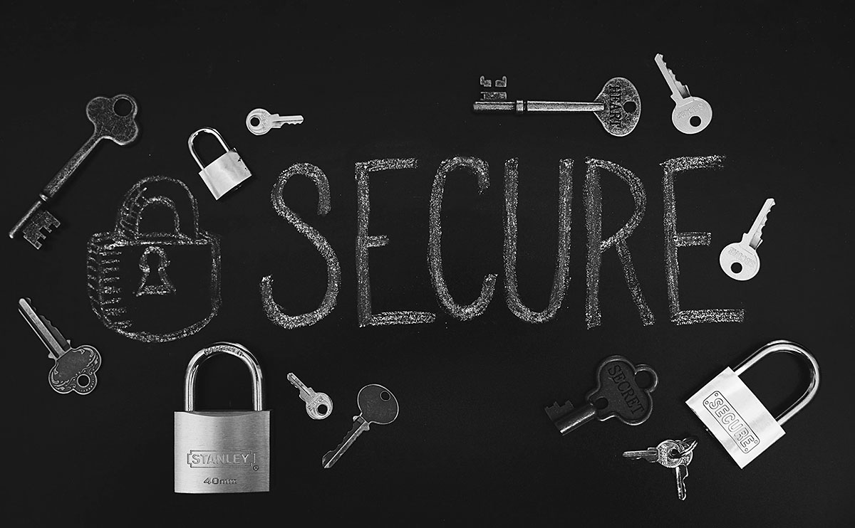 The word secure on a chalkboard with locks and keys